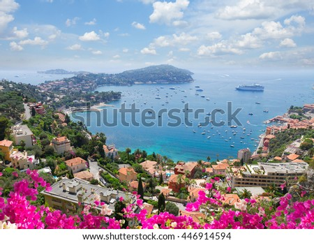 lanscape of riviera coast, turquiose water, flowers and blue sky of cote dAzur at summer day, France #446914594