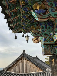lantern and roof detail of buddhist temple on bukhan mountain in bukhansan national park, gyeonggi, south korea