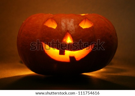 lantern, illuminating pumpkin in dark night