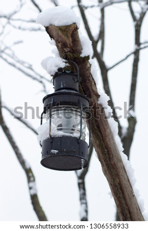 Lantern in a wintry atmosphere #1306558933