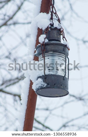 Lantern in a wintry atmosphere #1306558936