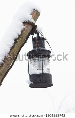 Lantern in a wintry atmosphere #1306558942