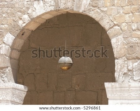 Lantern in an arched arcade. Ummayad mosque in Damascus. Syria.
