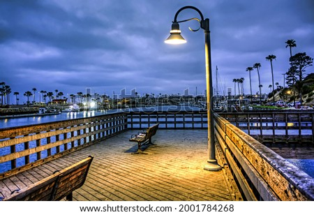 Lantern on the pier in the late evening. Street lamp on pier.