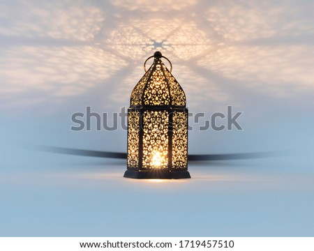 Lantern with reflection effect from top, use it as a background of greeting cards in religious occasions