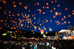 Lanterns being released during a large celebration.