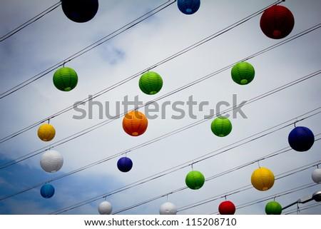 Lanterns candle display at blue sky.