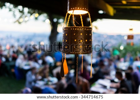 Lanterns for Ramadan with people crowd waiting for iftar - stock photo