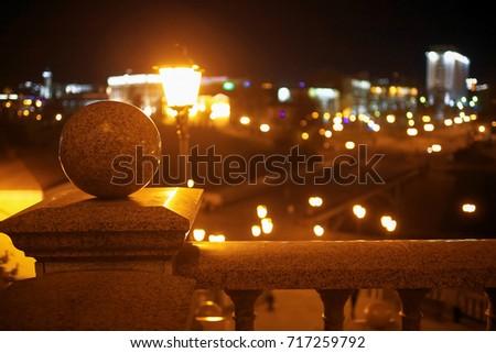 Lanterns illuminate a big city at night #717259792