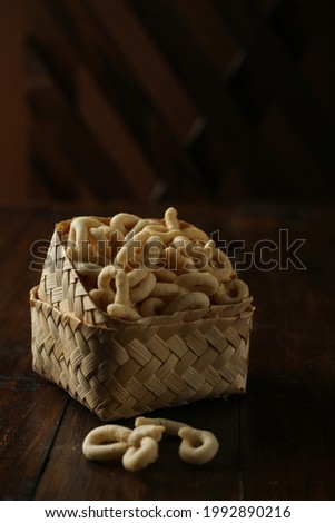 lanting is a traditional Indonesian snack made from cassava like crackers, it tastes salty and savory,on dark background