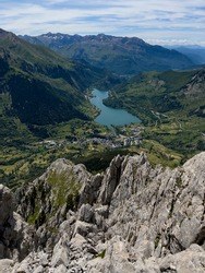 Lanuza Dam from the summit of Peña Foratata the most iconic peak in the upper Tena Valley, Sallent de Gallego; Pyrenees; Huesca; Spain