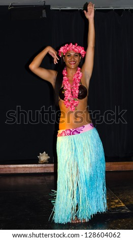 LANZAROTE, CANARY ISLANDS - MARCH 23: Cultural performance of Hawaiian traditional dressed dancer on Barcelo hotel stage on March 23, 2012 on Lanzarote - Canary Islands. - stock photo