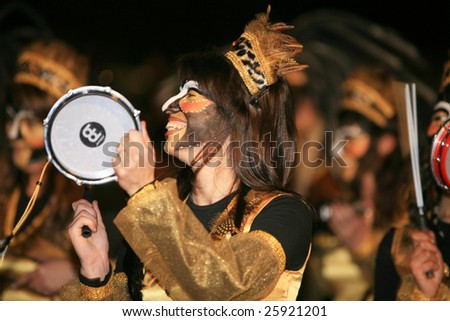 LANZAROTE, SPAIN - FEB 23: A drummer participates in the Grand Carnival Parade on February 23, 2009. Lanzarote, Canaries islands, Spain.