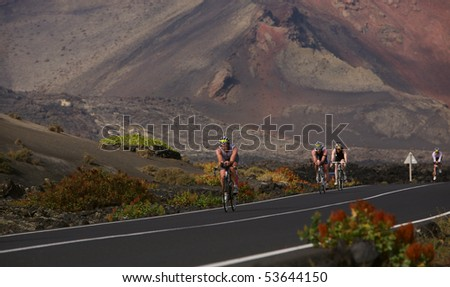 LANZAROTE, SPAIN - MAY 22: Group of cyclists in ironman Triathlon 2010 Event May 22 in Lanzarote Spain.