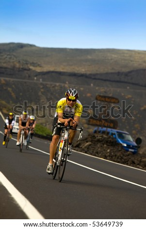 LANZAROTE, SPAIN - MAY 22: Group of cyclists in Ironman Triathlon Event on May 22, 2010 in Lanzarote Spain.