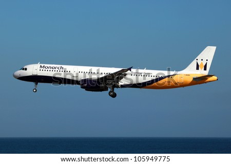 LANZAROTE, SPAIN - OCTOBER 8, 2011: Monarch Airbus on final approach on October 8, 2011 in Lanzarote, Spain. Monarch is a British airline with 32 jet airliners and 5.8 million passengers in 2010. - stock photo