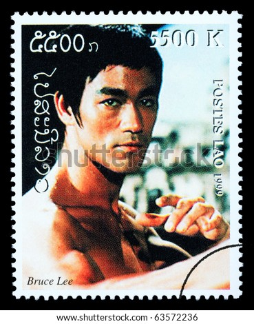 LAOS - CIRCA 1999: A postage stamp printed in Laos showing Bruce Lee, circa 1999