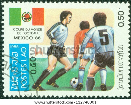 LAOS - CIRCA 1985: A Stamp printed in LAOS shows the Soccer Players, Football Field and flag of Mexico, series, circa 1985