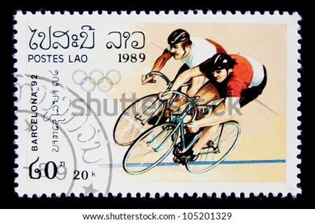 LAOS  - CIRCA 1989: A stamp printed in Laos shows two riders competing in a bike race, series Olympic Games in Barcelona 1992, circa 1989