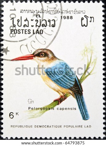 LAOS - circa 1988:stamp features a Stork-billed kingfisher bird (pelargopsis capensis), circa 1988 in the Lao People's Democratic Republic.
