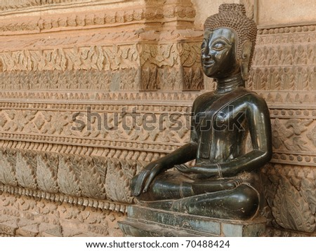 Laos, Haw Pha Kaeo temple in Vientiane. Once a royal temple built specifically to house the famed Emerald Buddha, is today a national museum of religius art. Buddha sculpture inside museum.
