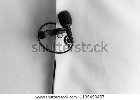 Lapel Microphone on a white shirt