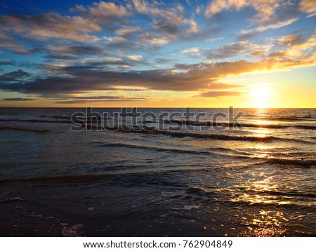 Lapping surf and ocean sunset