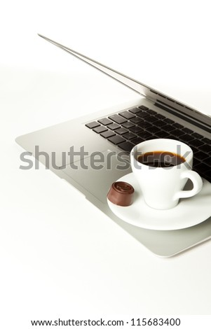 Laptop and a cup of coffee isolated on white