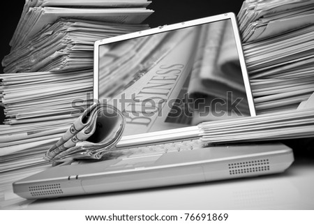 Laptop and Business newspaper