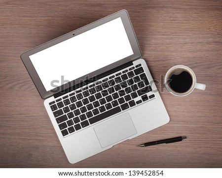 Laptop and coffee cup on wood table. View from above - stock photo