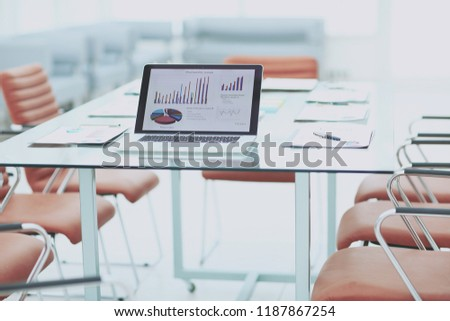 laptop and financial reports on the Desk of a businessman