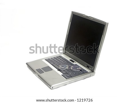 Laptop and glasses over white background