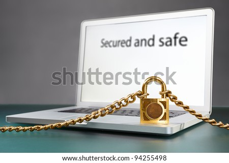 Laptop and locked chain for protection concept