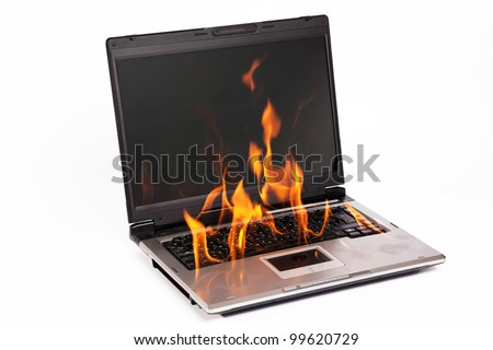 Laptop burning with fire on white background