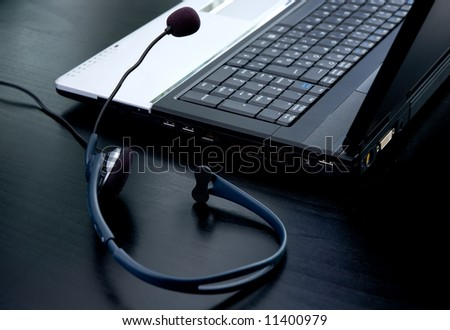 Laptop computer and headphone with microphone for voip conversations