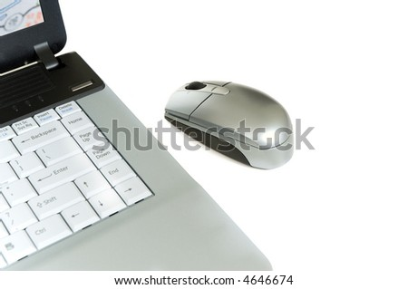 Laptop computer and mouse on white background