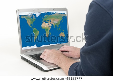 Laptop Computer and World Map Representing the World At Our Finger Tips