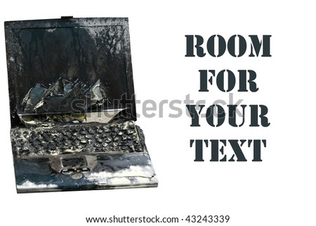 Laptop computer burned in a fire, represents computer damage, loss of data, emergency and more, isolated on white