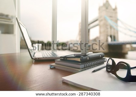 laptop computer is on wooden desk as workplace concept with overcast effect  #287340308