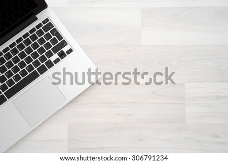 Laptop computer on a wooden desk, top view copy space #306791234