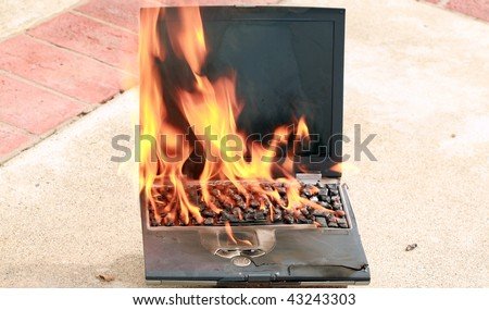 laptop computer on fire, represents computer damage, loss of data, emergency and more