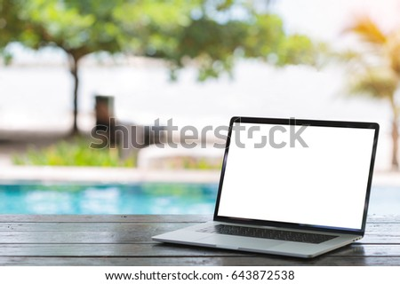 laptop computer on table white screen bach background