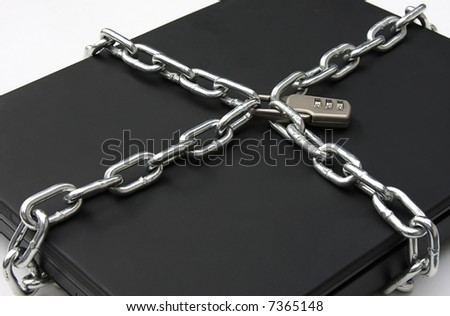 Laptop computer safely secured with chains and a padlock