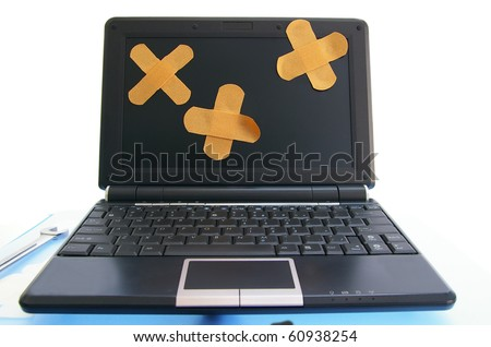 laptop computer with bandages - computer repair, or online healthcare concept