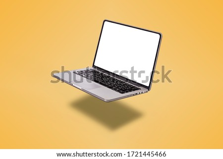 Laptop computer with blank screen isolated on yellow background