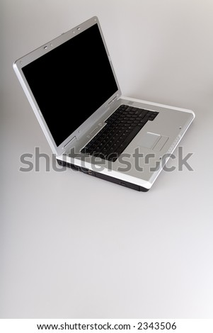 Laptop computer with cut-out black screen. View from top with space for text at the bottom.