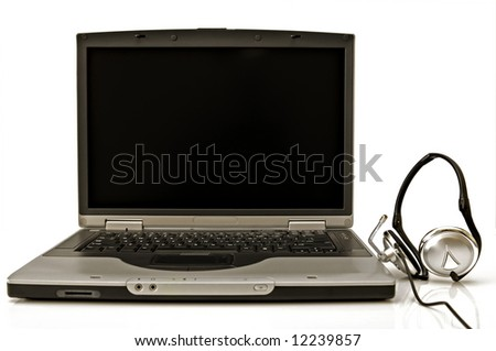 Laptop computer with headset close up shoot.