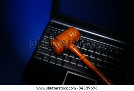 laptop computer with legal court gavel on keyboard