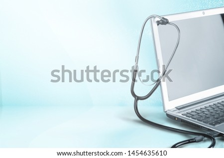 Laptop diagnosis with  stethoscope  on background #1454635610