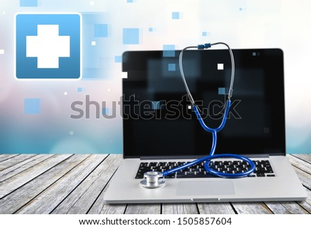 Laptop diagnosis with  stethoscope  on background #1505857604